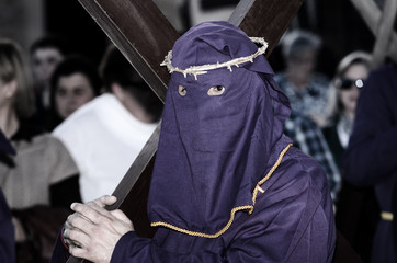 Via Crucis in Lorca, Spain with penitents bearing cross