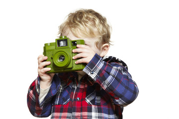 Young boy looking through a camera