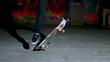 Skater rolling into kickflip trick