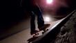 Skater dropping in on ramp