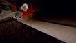 Skater doing frontside 5-0 along top of ramp