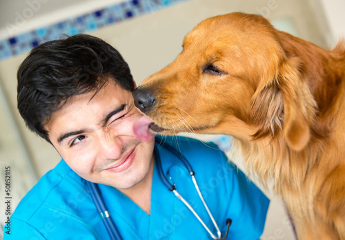 Dog kissing the vet