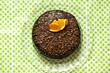 Chocolate cake rich with ganache and orange peel, top shot