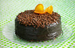 Chocolate cake covered with ganache and orange peel