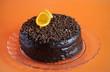 Chocolate cake with ganache, shavings and orange peel