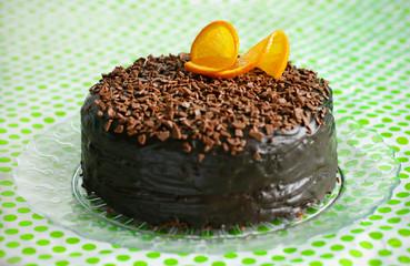 Chocolate cake covered with ganache and orange peel