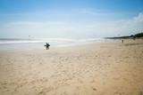 surfers on kuta beach bali indonesia