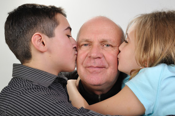 family portrait of elderly father with children