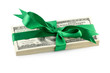 Pack of dollars tied with green ribbon isolated on white backgro