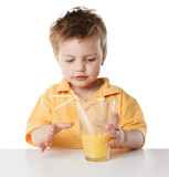 Portrait of happy little boy drinking orange juice. Isolated