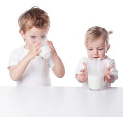 children drink milk, isolated on white background