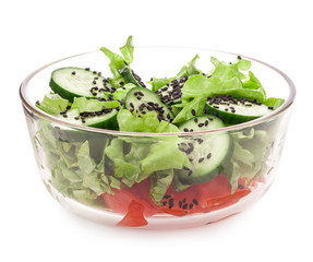 Salad of cucumber with sesame seeds in bowl isolated on white