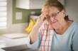 Sad Crying Senior Adult Woman At Kitchen Sink