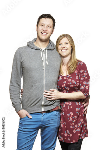 Young couple cuddling and smiling