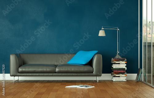 canvas print picture Ledersofa vor blauer Wand