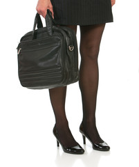 low angle of woman with beautiful legs holding briefcase