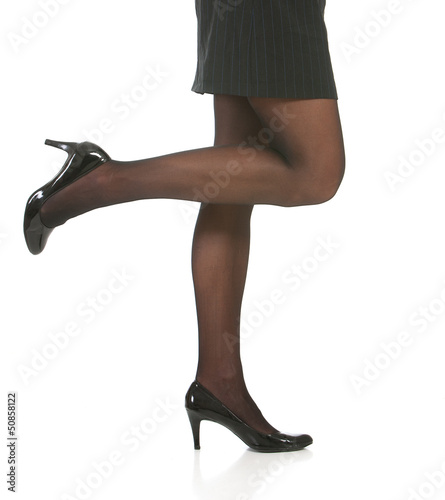 Low angle of legs and heels of business woman