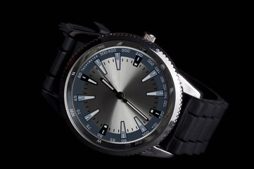 Men's metalic wristwatch, isolated on black background