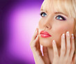 Beautiful blonde woman with manicure and purple makeup