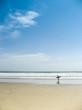 surfer on kuta beach bali indonesia