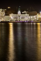 Trieste city hall and main square by night.