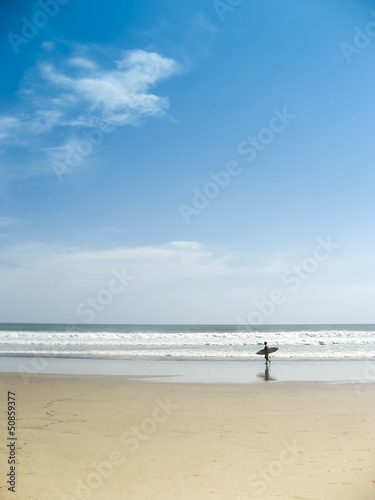 surfer on kuta beach bali indonesia