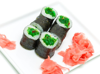 sushi with seaweed and ginger on a white background