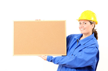Woman engineer cork board in hand