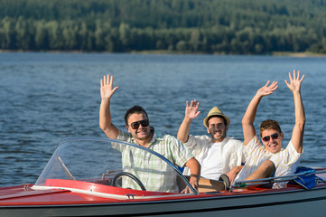 Cheerful young guys partying in speed boat
