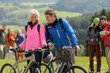 Cheerful cyclist couple with mountain bikes