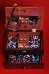 jewelry box with jewelry on a red background