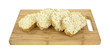 Frozen cheese bread on cutting board