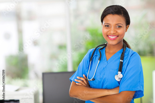 african american female pediatric nurse in office