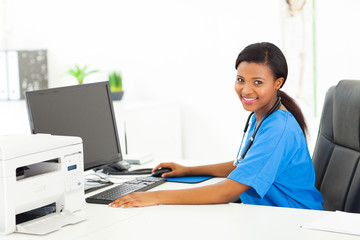 afro american female doctor sitting in her office