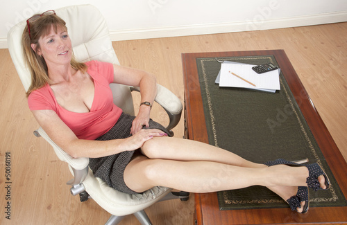 Quot Mid Aged Secretary Sitting With Feet On Her Desk Quot Stock