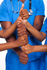 african american healthcare workers hands together