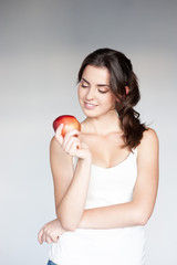 thoughtful girl holding apple