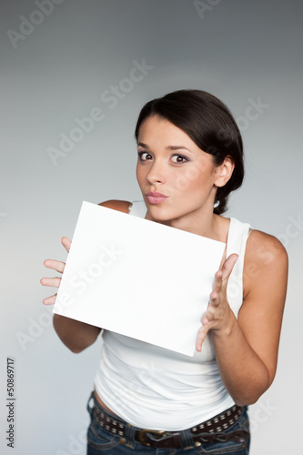 cheerful girl holding sign