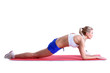 Sporty woman doing stretching exercises on mat
