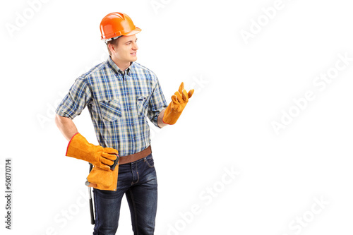 Young male contractor with construction helmet