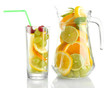 transparent jar and glass with citrus fruits and raspberries,