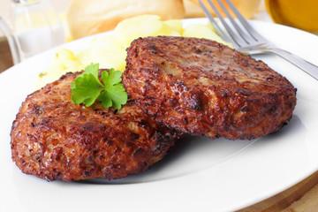 Beefsteak with potato salad - Frikadelle mit Kartoffelsalat