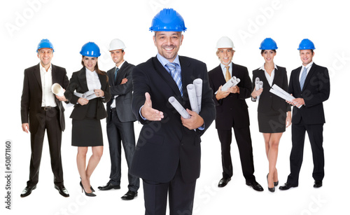 Portrait of happy architect and his team