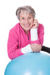 Senior Woman Leaning On Pilates Ball