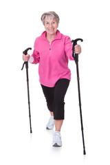 Senior Woman Walking With Hiking Poles