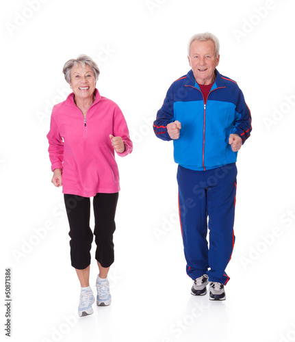 Portrait Of Senior Couple Jogging