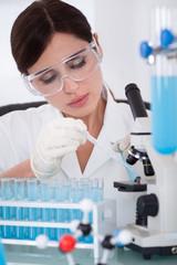 Female Scientist Analyzing Sample
