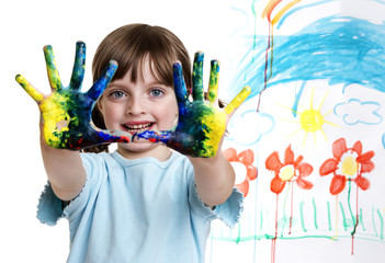 a little girl painting her happy picture