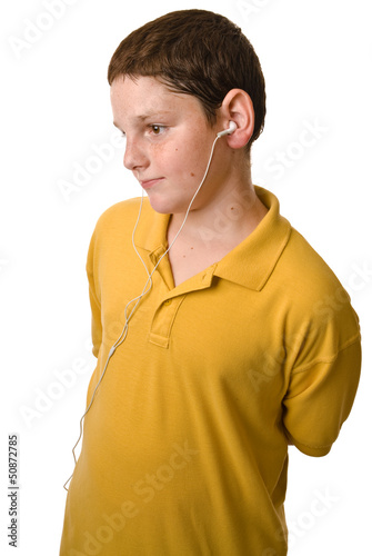 Young boy with ear buds in his ears