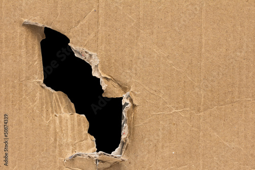 black hole in a cardboard background